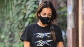 Malaika Arora in crop top and shorts with Rs 3k slides goes for a walk with Casper