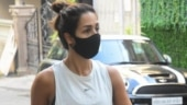 Malaika Arora in sleeveless top and printed tights goes minimal for day out. See photos