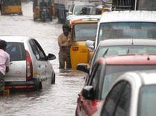 Cyclonic rains lash Andhra, cut off coastal areas
