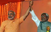 2014 polls: Narendra Modi, Nitish Kumar 'battle' to become NDA's choice for PM post