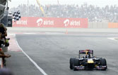 Tendulkar waves chequered flag as Vettel wins