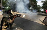 Police fire tear gas shells at protestors