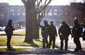 Virginia Tech cop, 1 other killed in campus shootout