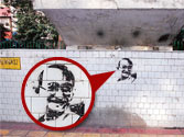 Graffiti artists desecrate Mahatma Gandhi's image on loo wall in Delhi