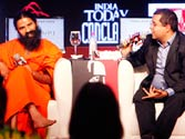 Baba Ramdev and Chetan Bhagat at the India Today Conclave