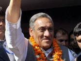 Vijay Bahuguna sworn-in as Uttarakhand CM, Harish Rawat revolts