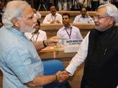 Lalu Prasad hits out at Nitish Kumar for shaking hands with Narendra Modi at NCTC meet