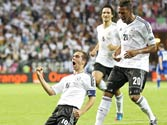 Euro 2012: Germany beat Greece 4-2 to reach semis