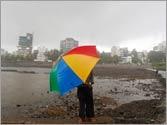 Monsoon hits Mumbai but Delhi still reel under searing heat