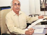 Competition Commission of India chairman Ashok Chawla cracks down on carmaker cartel