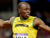 Bolt scorches track at Olympics, defends his 100m title