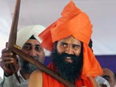 Cops prepare for crackdown as Baba Ramdev, supporters threaten march towards Parliament against 'insensitive' govt