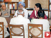 Sonia says no threat to UPA, backs PM