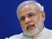 Narendra Modi scoffs at Congress for free laptop promise