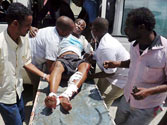 Suicide bombers strike Mogadishu restaurant, 15 killed
