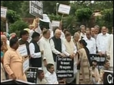 NDA leaders demonstrate in Parliament on coal issue