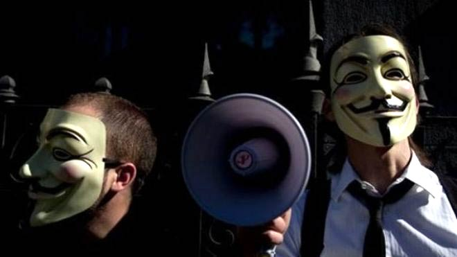 People wearing masks often used by a group that calls itself