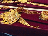 Gold prices surge upwards on increasing demand, at a record high of Rs 32,950