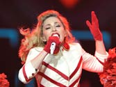 Madonna does it again! Strips, asks fans to throw money at her