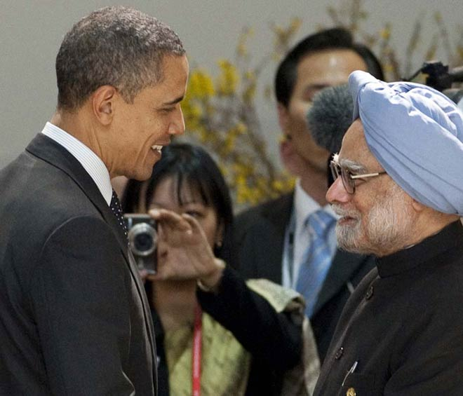Barack Obama (left) greets Manmohan Singh at the Seoul nuclear security summit on March 26, 2012.