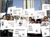 Activists protest outside UN talks on climate change in Doha