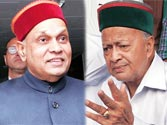 Himachal CM Prem Kumar Dhumal (left) Virbhadra Singh of the Congress