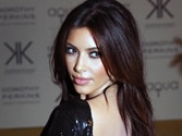 Kim Kardashian strips for bikini shoot