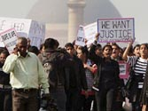 Call for justice for gangrape victim grows shriller as she continues to battle for life