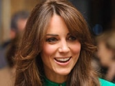 Duchess Kate loves her first official portrait, critics don