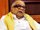 DMK chief Karunanidhi warns of pulling out of UPA government over killing of Lankan Tamils