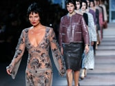 Kate Moss walks the ramp in a see-through dress