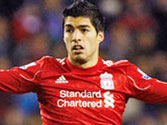 Liverpool striker Luis Suarez in dock for punching opponent