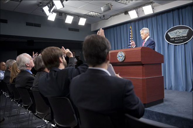 Defense Secretary Chuck Hagel tells reporters that US will add 14 interceptors to a West Coast-based US-based missile defence system.
