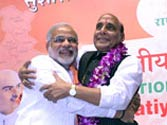 Victory: Modi and Rajnath Singh steamrolled Advani's opposition to fashion the new team to their liking