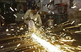 Factory output rebounds to 2.5% in March, grows a tad 1% in FY13