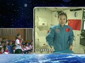Chinese astronauts float water blob in lecture for kids