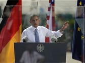 Obama's Berlin wall! US Prez calls on Russia to revive a 'world without nuclear weapons,' from behind bulletproof glass