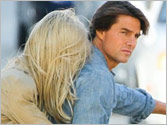 Tom Cruise enjoys biking with mystery woman
