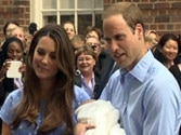 Kate Middleton and Prince William show off Britain's royal baby