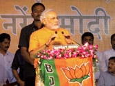 Congress hiding behind a veil of secularism to cover its failures, says Narendra Modi
