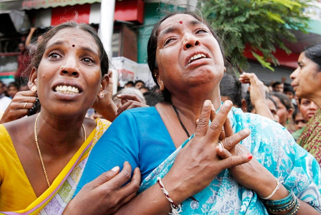 Women cry at the site of a building collapse in Secunderabad