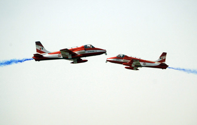 The Suryakiran team rehearses for India's Air Force Day in New Delhi October 6, 2005. Photo: Kamal Kishore/Reuters.