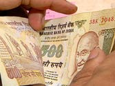 Rupee breaches 64-level against dollar, Sensex below 18,000