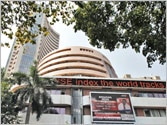 Sensex inches up slowly despite falling Rupee