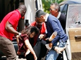 Gunfire erupts after Kenya says all hostages freed in mall siege