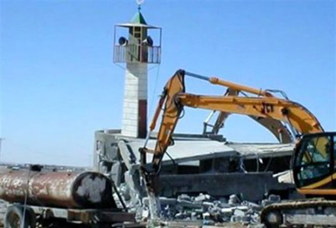 A minaret being demolished in Angola.
