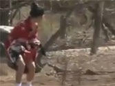 See how a Japanese woman is tempting a wild dragon with a meat piece tied around her waist