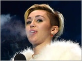 OMG! After twerking Miley Cyrus dares to smoke a joint at MTV EMAs