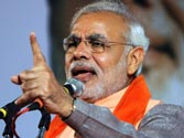 Narendra Modi hits back at Sonia Gandhi with 'microscopic' comment