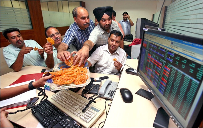 Sensex hits new record high of 21, 293, market says Happy Diwali